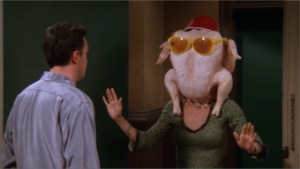 Monica puts turkey on her head