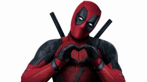 Deadpool making a heart with his hands at you through the fourth wall.
