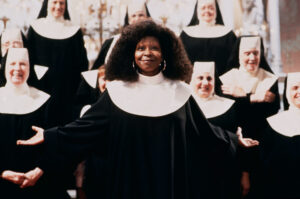 Whoopi Goldberg as Deloris Wilson/Sister Mary Clarence in front of nuns.