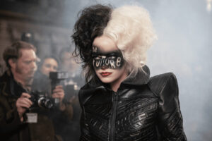 """Cruella with """"the future"""" written over her face in makeup."""